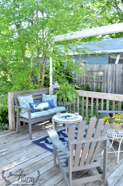 Seating area on a deck with a DIY penny tile table top