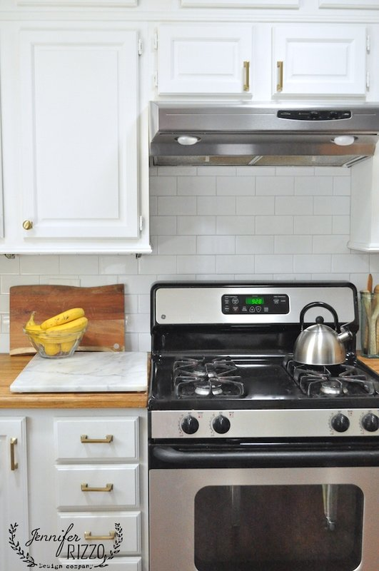see the beautiful neutral subway tile backsplash in this kit