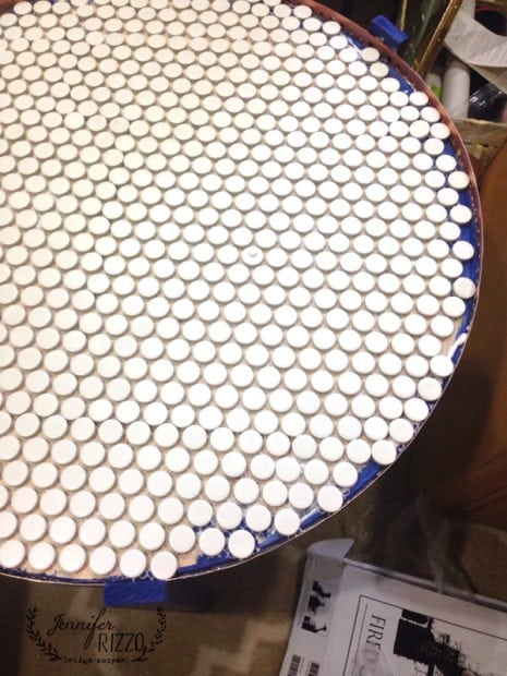 Tile laid out for a DIY penny tile table