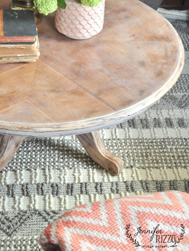 Rug and natural wood coffee table