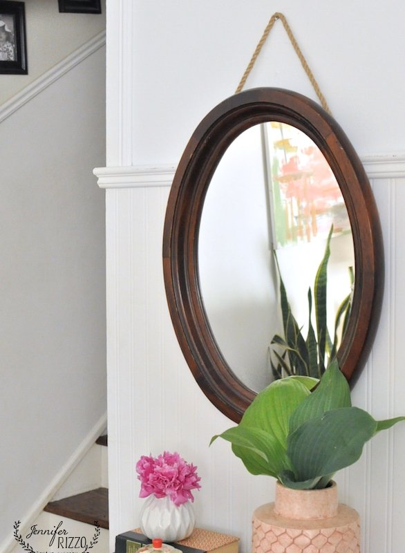 I love this vignette with the wood rope mirror and white walls.