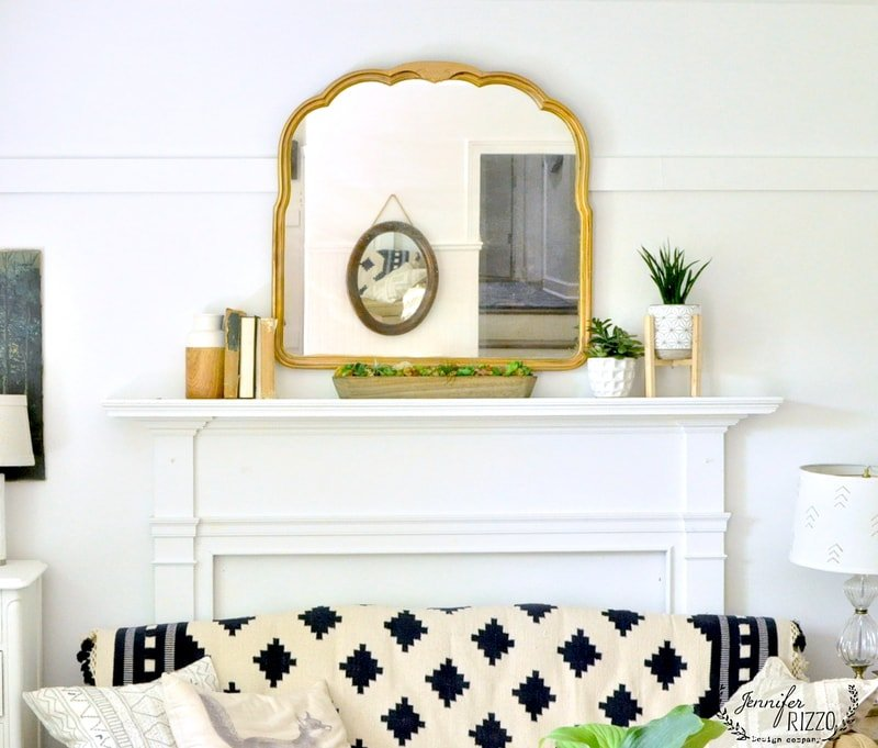 LIving room gold mirror rug on couch - Jennifer Rizzo