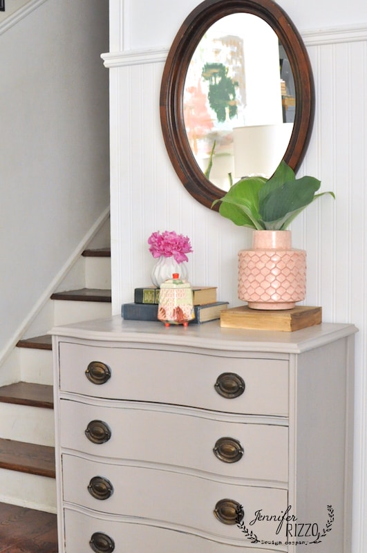 Vignette on Muchroom paint colored dresser and pink vase. Love the idea of using Hosta in a vase!