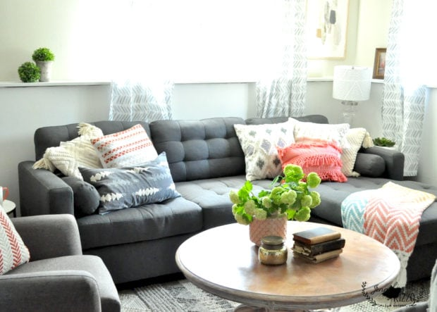 Basement family room with coral and gray