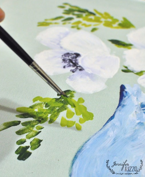 Adding greenery to flowers in acrylic paint