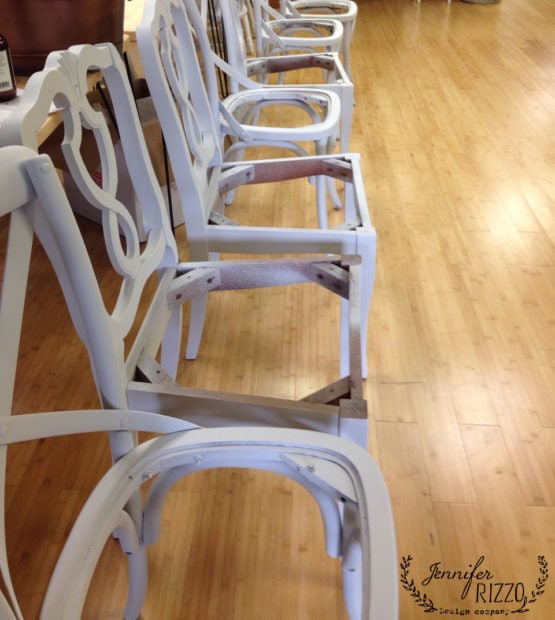 Painting chairs with a sprayer to unify them