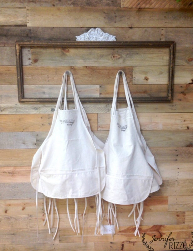 Aprons in the Collective Makery and retail space with a woad pallet wall