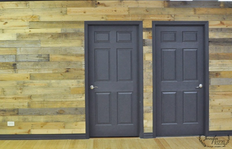 gray doors and a wood wall