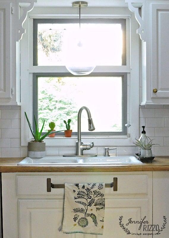 Kitchen window with globe pendant light