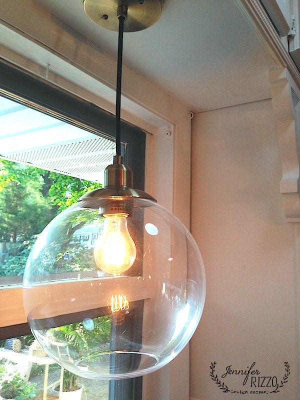 Globe pendant light with vintage style bulb