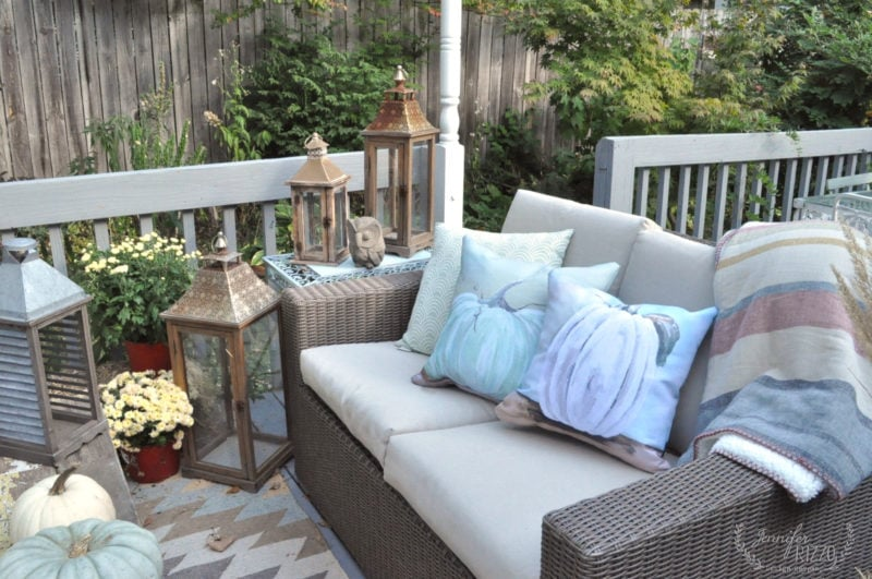 Fall deck decorating with lanterns and mums