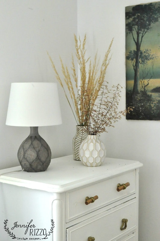 Boho vases filled with grasses
