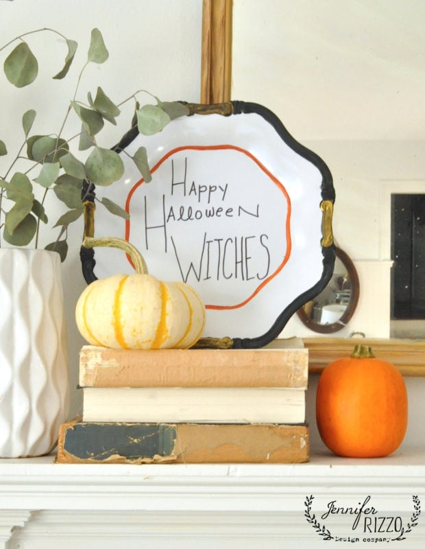 Happy hand lettered Halloween plates and mantel decorating idea