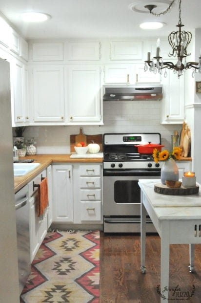 Jennifer Rizzo kitchen with early fall touches , and a repuposed desk into kitchen island