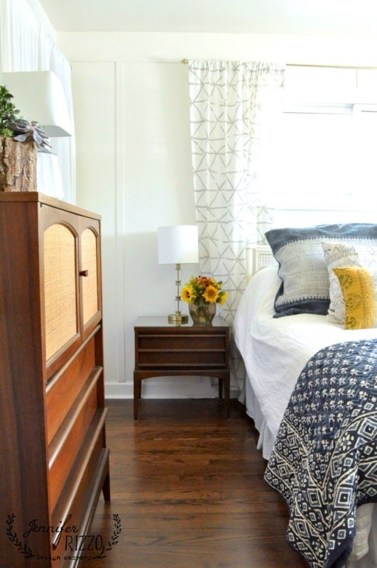 Beautiful wood floors in a boho MCM bedroom