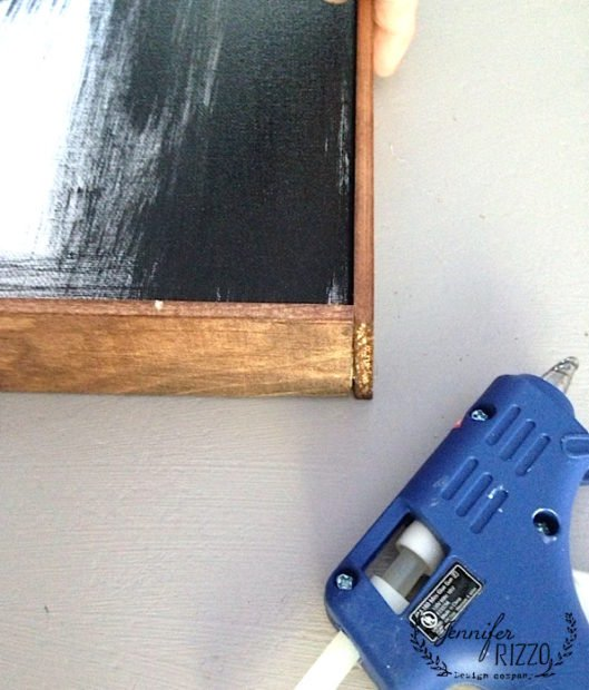Join corner together with hot glue to make an inexpensive canvas frame