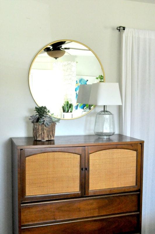 MIdcentury modern dresser and modern round mirror
