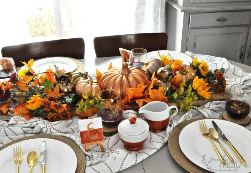 A metallic fall tablescape and fresh flowers