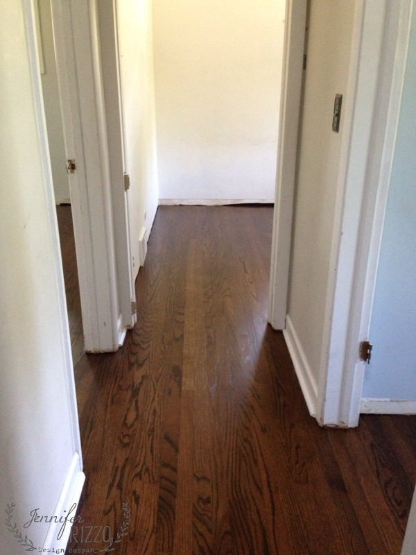 refinihsed wood floors in hallway