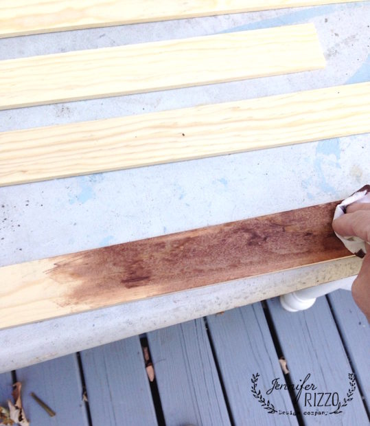 Stain pine slats to make an inexpensive picture frame.