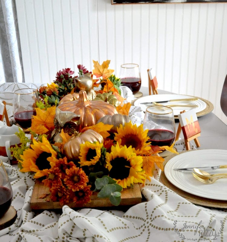 Sunflower and metallic fall tablescape woth wood trough centerpiece