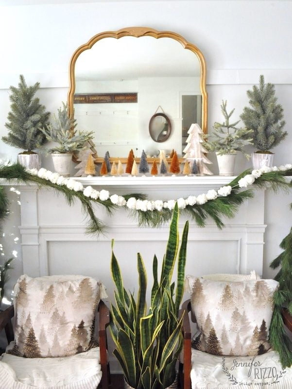 Boho holiday tree mantelscape with deck the holiday decor, bottle brush trees, pom pom garland, and live greenery