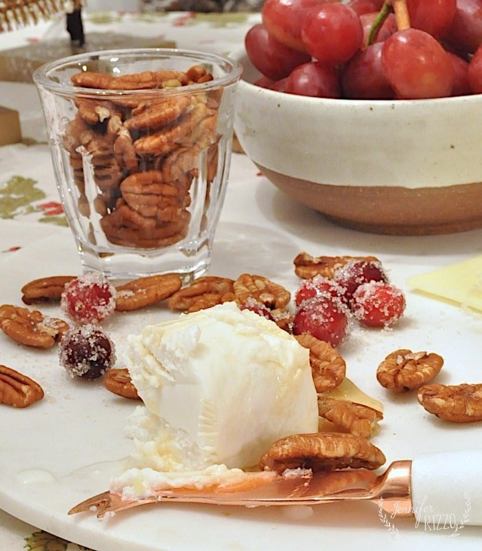Goat cheese and honey on marble with pecans