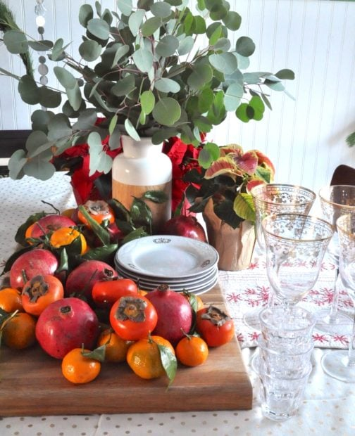NAtural removable fruit tablescape with pomegranates,oranges and persimmons