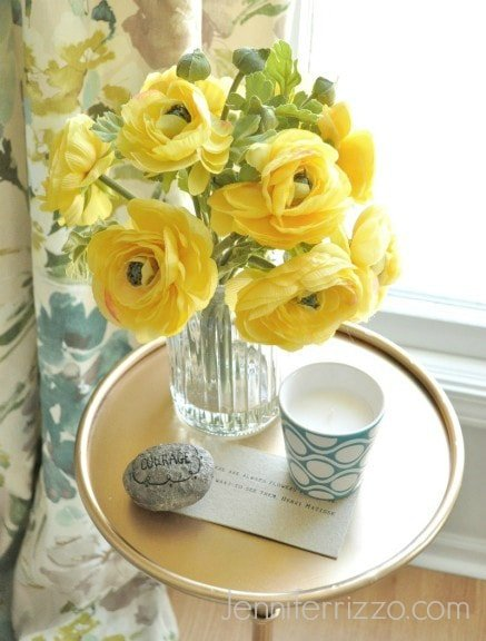 Yellow flowers on nightstand for a guest visit