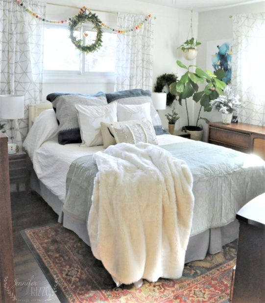 Holiday bedroom with simple touches and window garland