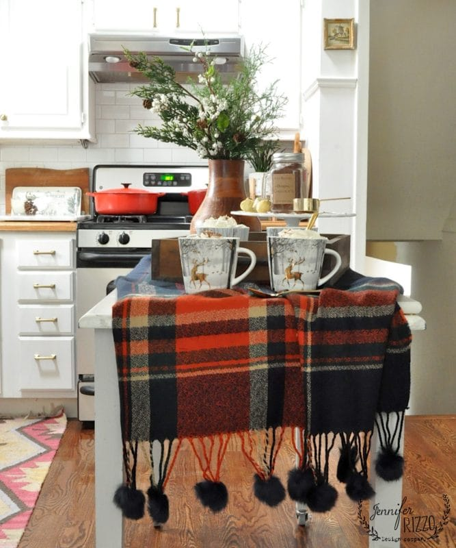 Plaid table runner and winter mugs for cocoa in Jennifer Rizzo's Christmas kitchen