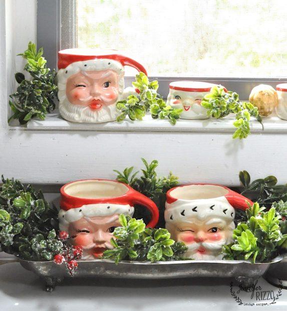 VIntage Santa mugs on a windw sill