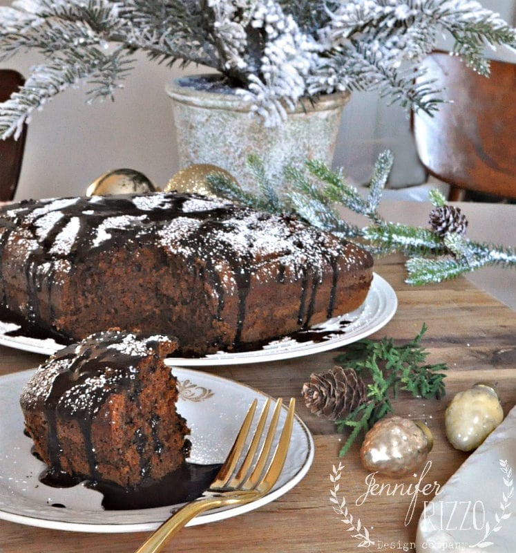 Spiced gingerbread cake recipe with chocolate drizzle and powdered suger