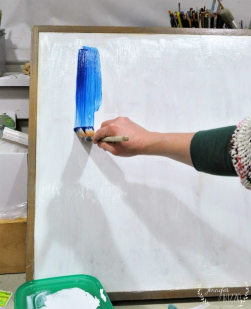 Start painting your abstract art by making wide strokes downward