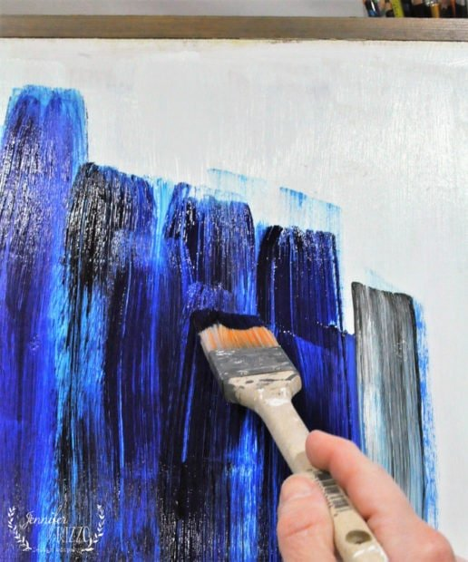 Painting abstract living room art with wide brush strokes in Carbon Black and Pthalo blue.