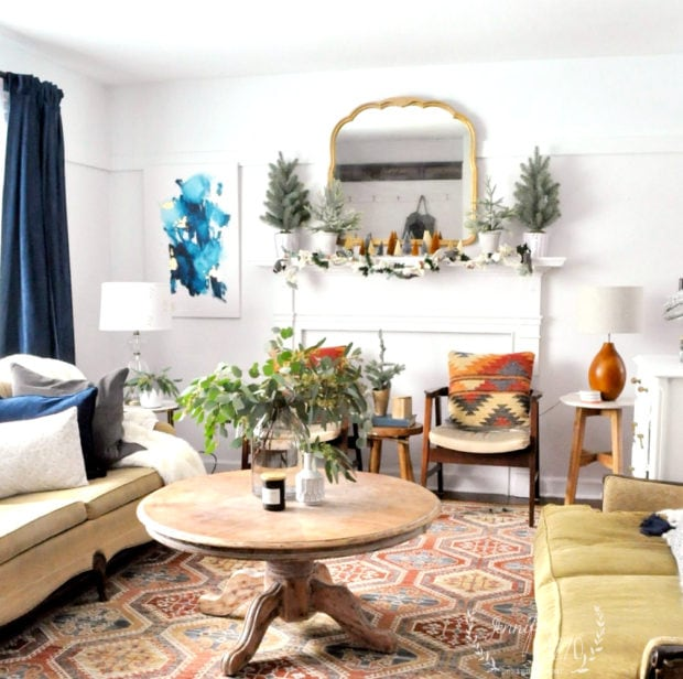 Mid-winter living room decor, a touch of modern abstract art with navy curtains