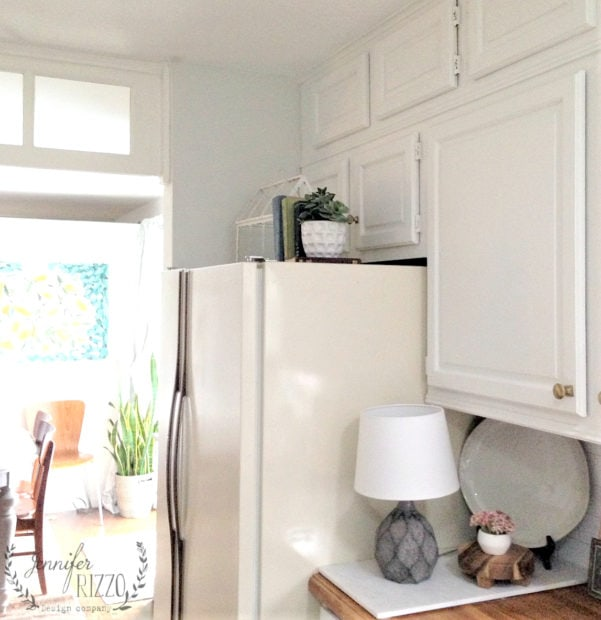 Painted area over fridge with cabinets