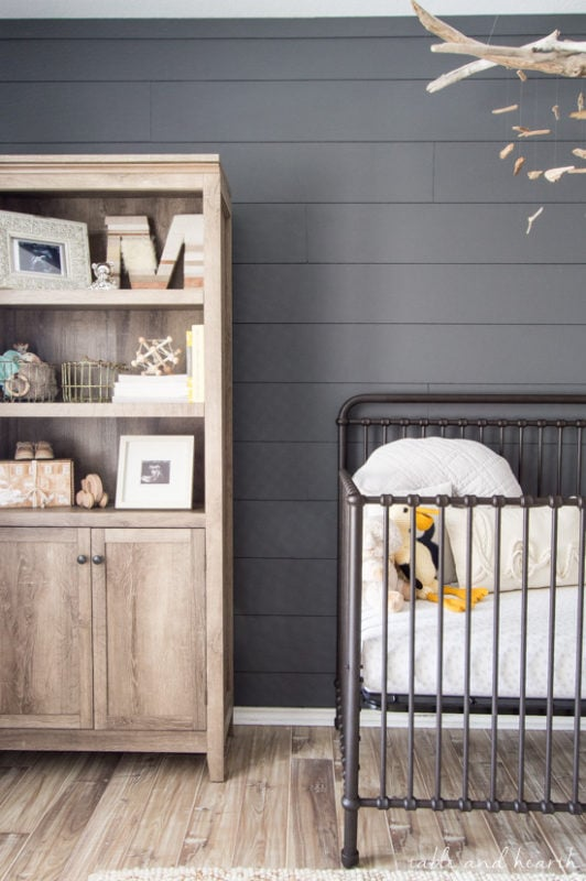 Table and Hearth dark gray baby nursery with accent wall