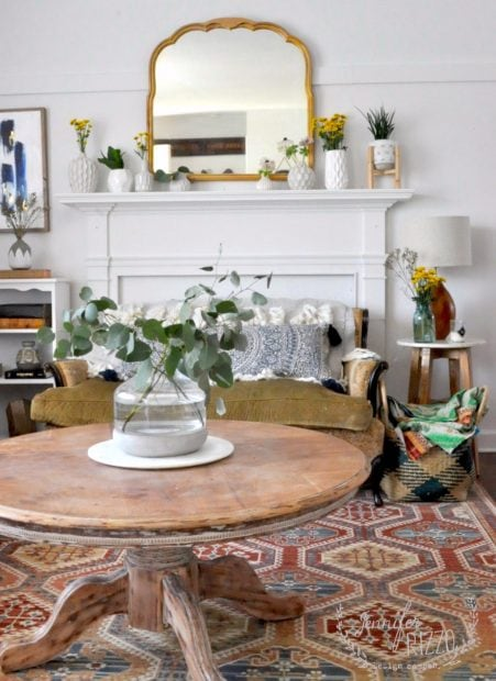Modern Boho living room with flowers on a faux mantel