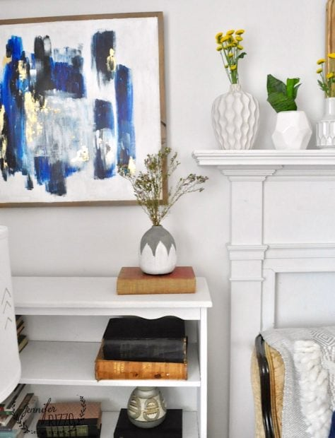 Boho vases and vintage books #vintagedecor, and spring home decorating refresh with flowers.