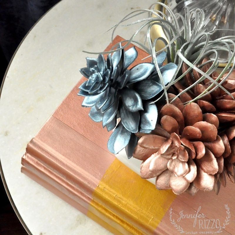 Metallic painted succulent planter and painted books