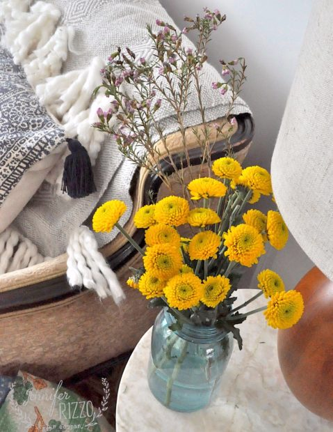 Yellow flowers in vintage blue vase