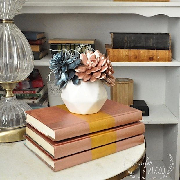 Decorative faux succulent planter with metallic painted books