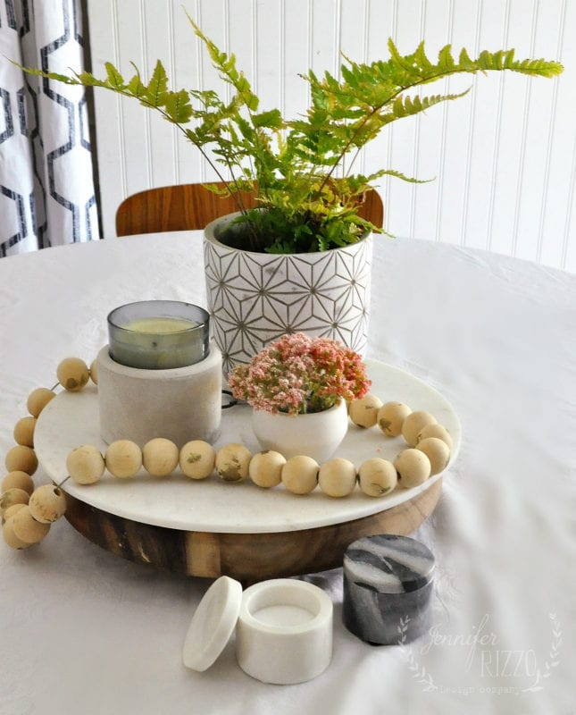 Boho vignette with fern and marble table ware
