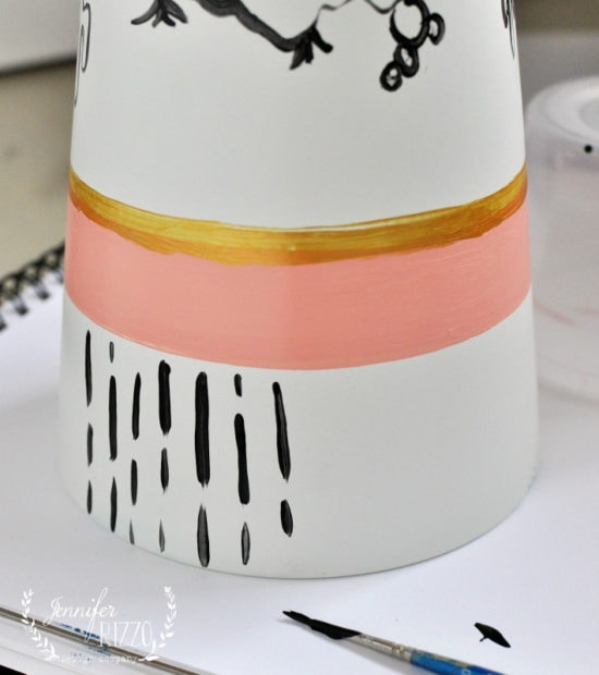 Paint lines on a DIY vase, Great Ikea hack and fun custom project.