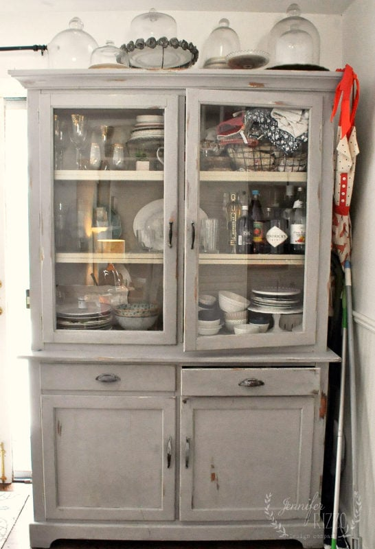 Kitchen hutch before furniture makeover with paint