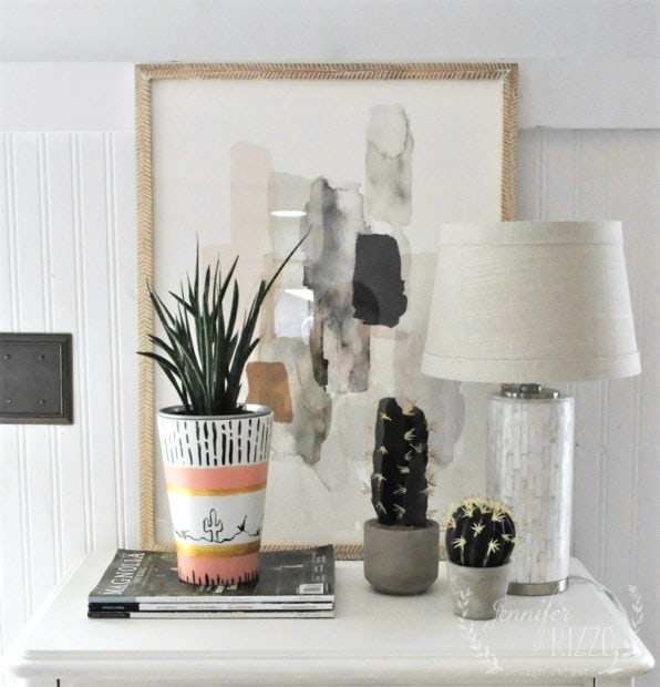 Front door vignette with abstract art,boho vase,and cactus