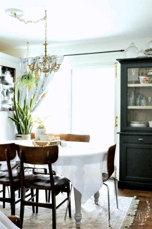 MCM and boho dining room idea, with vintage brass chandelier.