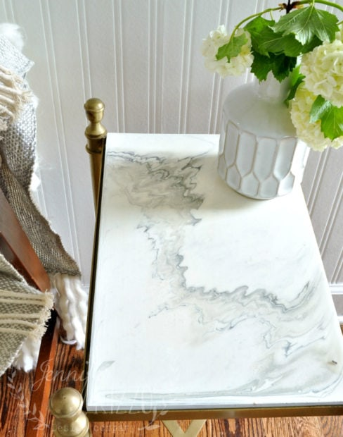 Faux marble top made with pouring medium and a top coat