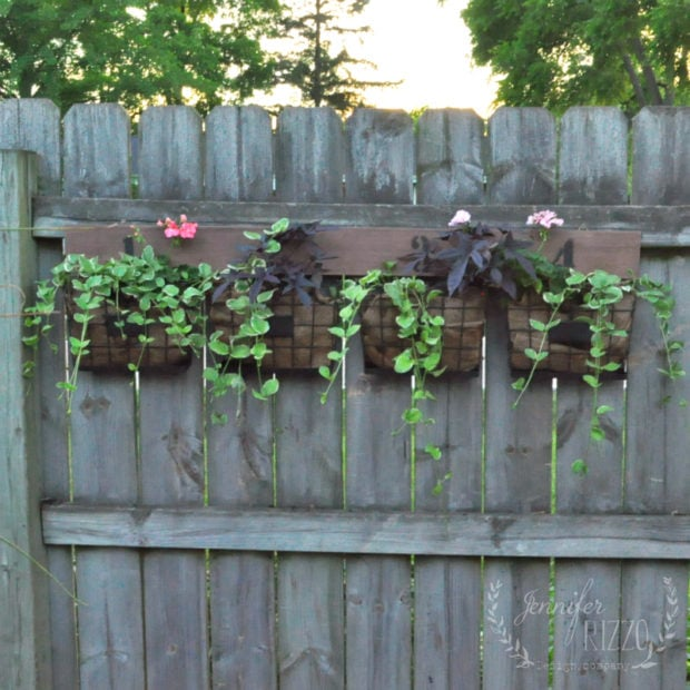Easy and fun fence planter made from a numbered storage organizer by Jennifer Rizzo